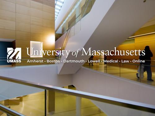 UMass logo overlaid on interior view of UMass Medical School