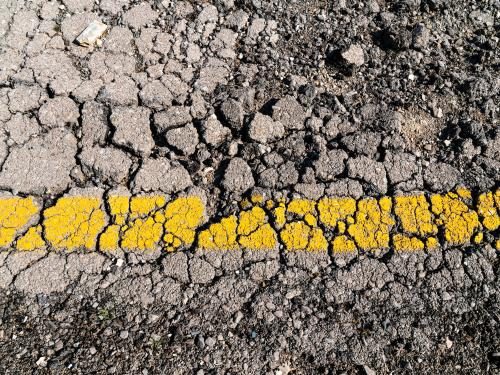 Close up of cracked highway road