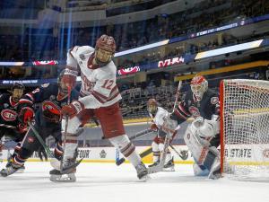 UMass Amherst hockey player shoots on the net