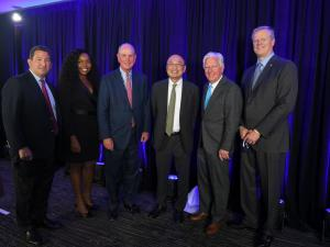 L-R: UMass Board of Trustees Chair Rob Manning, UMass Chan Medical School graduate and UMass Trustee Dr. Chioma Okwara, UMass Chan Medical School Chancellor Dr. Michael Collins, Dr. Gerald Chan, UMass President Marty Meehan, and Gov. Charlie Baker