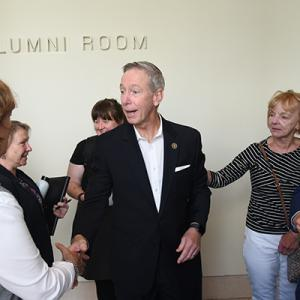 U.S. Rep. Stephen Lynch shakes hands with faculty. Image by: Harry Brett