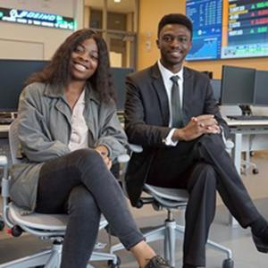 After growing up in U.S. embassies around the world, siblings Brit and Easmond Tsewole are enrolled in the Manning School of Business – and following in their parents' UMass Lowell footsteps.