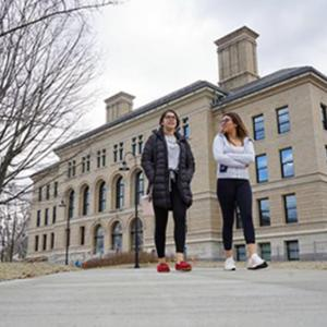 Students walk down the new universal access path in front of Coburn Hall, which is reopening for classes this semester after undergoing a $47 million renovation and expansion.