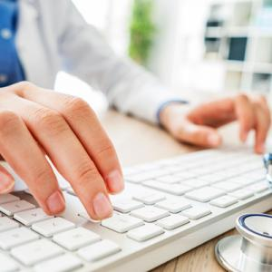 Doctor types information into a computer