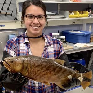 Nadia Fernandez holding a golden dorado.