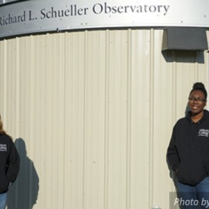 Honors physics majors Michele Woodland, left, and Shanice Kelly outside the new Schueller Astronomical Observatory on campus.
