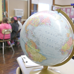 Image of a globe in a classroom