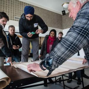 Clean Energy Corps students review architectural plans as part of their energy audit. Credit: Ben Barnhart/UMass