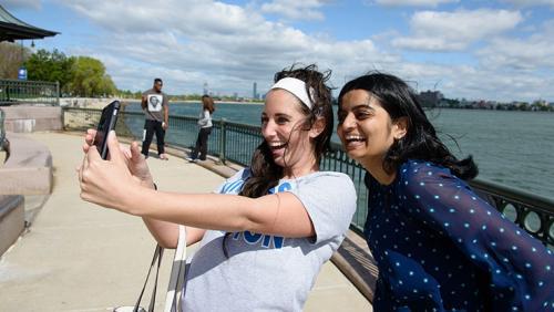 Students taking selfie at UMass Boston