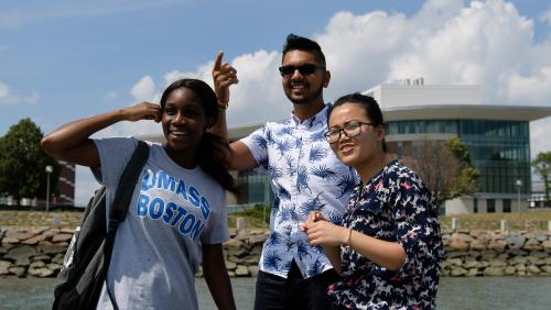 Three smiling UMass Boston students