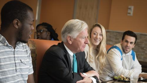 President Meehan speaks with students
