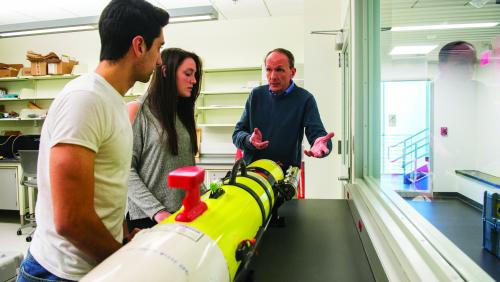 Students work with professor in SMAST