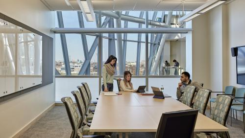 Students work in conference room on campus