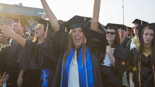 Excited student at UMass Amherst commencement